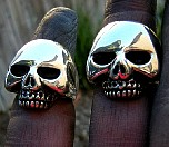 007-Its Only Rovk n Roll Skull Rings.JPG