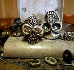 033. Skull Rings On TC's Workbench.JPG