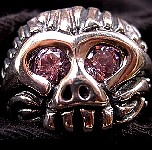 66M. Pink Eyed Monkeyman Skull Ring.jpg